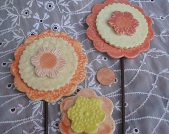 Darling Ceramic Flower Garden Stakes in orange and yellow.