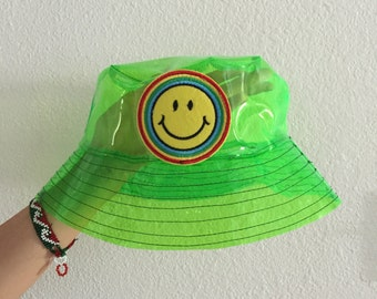 Green neon smiley face bucket hat, grunge bucket hat, rave, vapor wave, see through hat, waterproof hat, rain coat, festival accessories