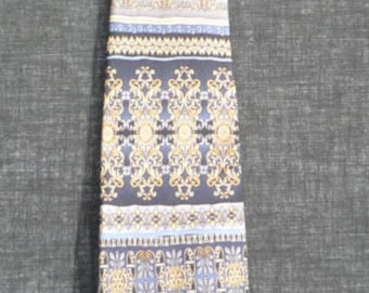 ROTARIAN SILK TIE blue and gold by Russell-Hampton Serving Rotarians Since 1920 says the tag.