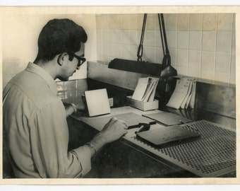 Young man testing seeds- original vintage 1960s photo- agriculture- guy at working at desk- United Nations FAO photo- Rockefeller foundation