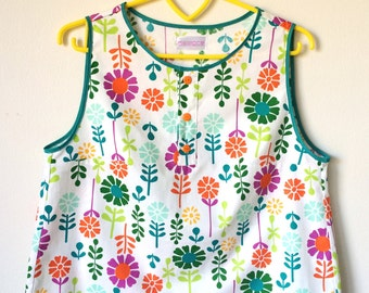 Unique, colorful sleeveless cotton summer top with retro flowers and button placket made in Sydney, Australia