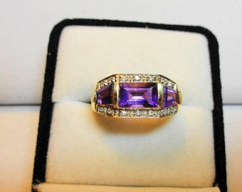 Amethyst Ring.  Amethyst in a 14kt. gold Past, Present, and Future Ring.