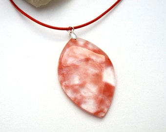 Clear red Agate pendant with red cord