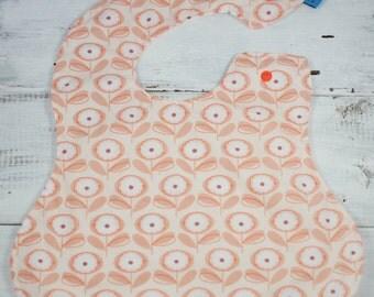 Waterproof baby bib in Playful Petals, flowers, full coverage, oversized,
