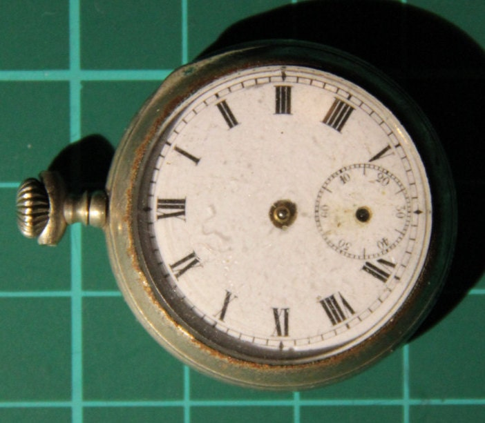L W Co  Swiss Made Small Nickel Plated Steel Pocket Watch for Parts