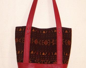 Tribal handwoven ikat fabric and dark red leather handbag purse