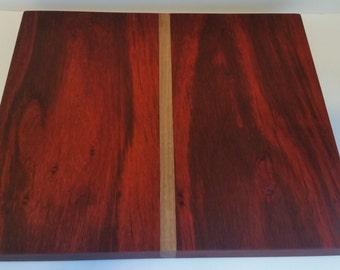Paduak cutting board with walnut stripe.