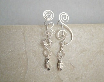 Whimsical wire squiggle earrings with sterling cube beads.  Mismatched earrings by Devine Designs Jewelry