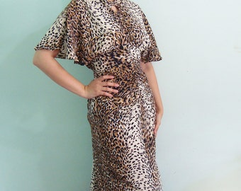 Purrrfect Leopard cape sleeve dress - keyhole cut out