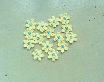 Crochet Flowers Appliques 117.22 --- 12 pcs --- Tiny Size flowers in Yellow Petals with Centre in Bright Blue