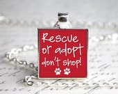 "Rescue or Adopt Don't Shop One Inch 1"" Pendant Necklace with Paw Print Organza Bag"