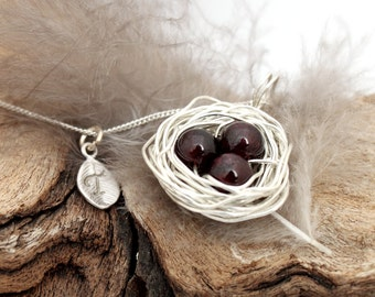Personalized bird nest necklace with three garnet eggs and initial charm- silver plated woven wire- January birthstone- crystal healing