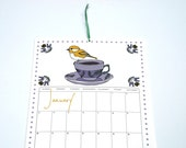 2016Wall Calendar, 11x17 Inches featuring 12 different illustrations in mustard, purple, rose pink, slate gray and green