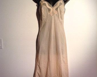 Beige slip. All Nylon, Sheer chiffon Detail.  Munsingwear, size 32.  Vintage 1960.  New Old Stock.