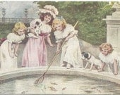 Fishing in the fountain 4 Girls with Puppies Netting Gold Fish very Sweet Victorian Vintage Postcard 1910-1920's