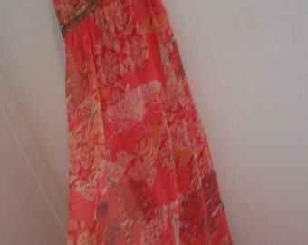 Hippie long dress  beaded front design with pretty orange  coral colors and beaded sleeveles  front. Sixe M