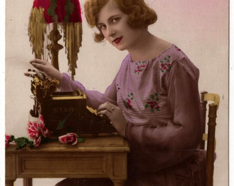 Postcard of Star (Sun) Typewriter with Pretty Girl