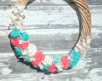 18 Inch Wicker Wreath with Handmade Teal, Antique White, and Coral Fabric Flowers. Fun Bright Colors!