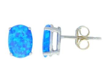 14Kt White Gold Blue Opal Oval Stud Earrings