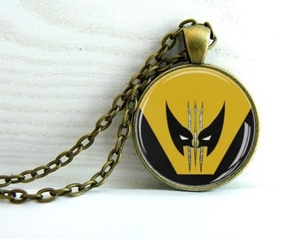 Wolverine pendant.  Clear glass dome 25 mm on antique Brass frame, Brass chain.