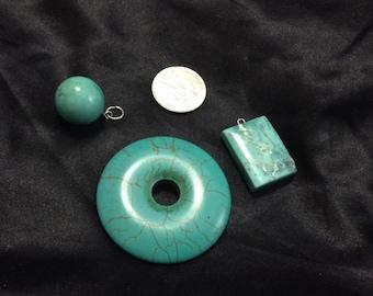 Three turquoise colored gemstone pendants