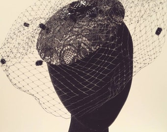Black lace button fascinator with floral beaded embellishment and veiling