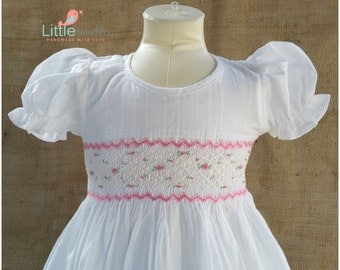 Gorgeous white hand smocked dress with hand embroidery