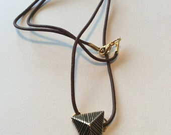 Gold patterned triangle on waxed brown leather cord necklace