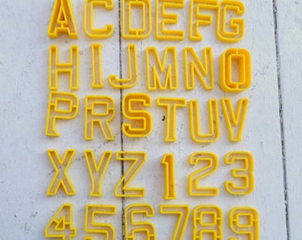 1970s Yellow Plastic Letters and Numbers, Set of 34