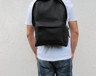 Leather Backpack available in 16 colors and two sizes. Unisex