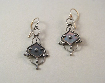 Sterling silver dangle earrings.  Handmade.  Unique.  Limited edition.  Wanting to be flowers.