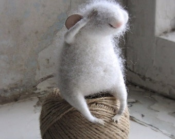 Felt mouse. White fluffy mouse.