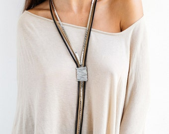 Statement necklace, Leather necklace, Long necklace, Wrapped necklace, Stylish necklace, Silver necklace, Elegant necklace, Large necklace.