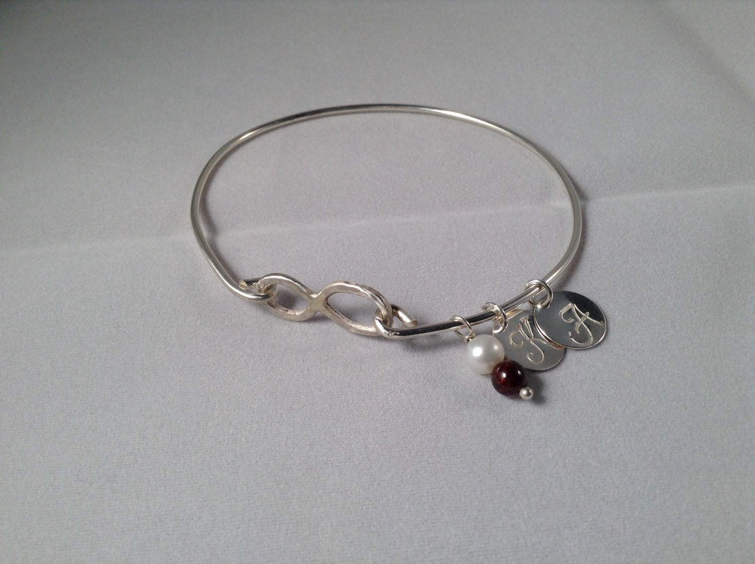 sterling silver eternity bracelet with 2 initial charm