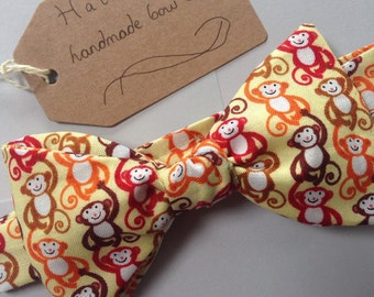 Handmade baby bow tie in a monkey patterned fabric