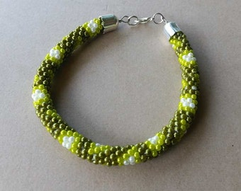 White - dark green - light green bracelet from small beads with a beautiful metal fastening
