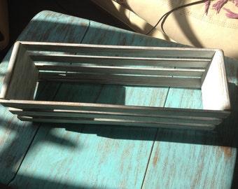 Distressed white wooden CD/storage rack.