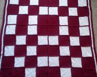 Afghan in Red and White Colors.