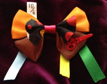Handmade Mad Hatter hair bow inspired by Alice in Wonderland!