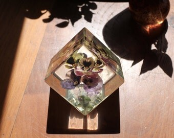 Vintage and unique cube of encapsulated real flowers in resin