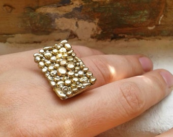 Rectangle brass ring with brass drops