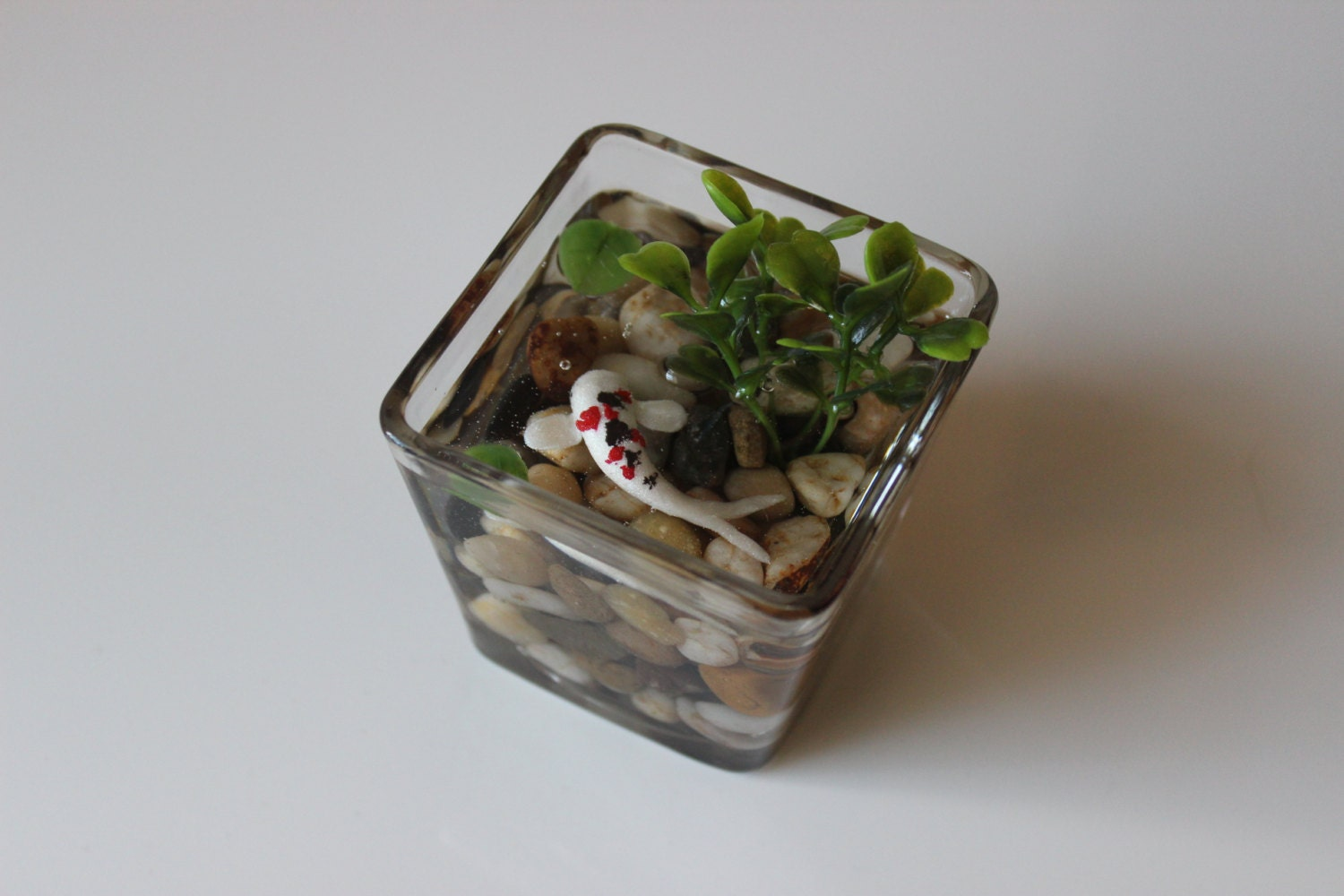 Miniature koi pond in glass bowl fake koi pond by for Artificial koi fish for ponds