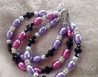 Purple/pink 3 strand bracelet
