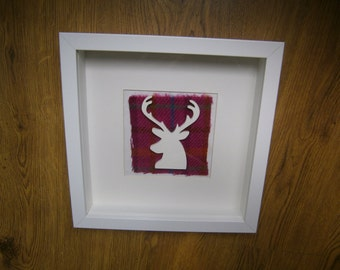 SALE    Framed stags head with Harris Tweed™ background available in black or white frame.