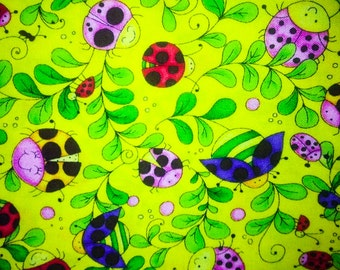 Quilting Treasures Cute as a Bug, Yellow with pink, blue, yellow, and green lady bugs ~11