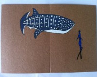 Freediver with whale shark card