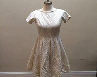 1950s tea-length white dress
