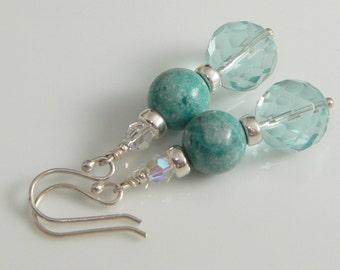 Blue/Green Turquoise Stones, Swarovski Crystals and Faceted Glass Beads with Sterling Silver findings.