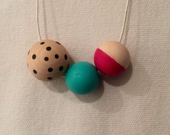 Wooden bead necklace // hand painted in hot pink, aqua and black
