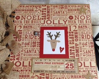 Christmas keepsake album. Photobook/ Memorybook /Scrapbook Handmade with Rudolf The Red Nose Reindeer image. SIZE 8 x 8 inches.